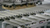 roller conveyor : Furniture manufacturing. Furniture parts are packaged on an automated packaging line. 4K