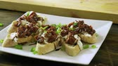 моцарелла : Italian food. Bruschetta with dried tomatoes, mozzarella cheese, balsamico sauce, green onion. 4K