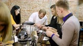 clams : A group of people preparing mussels with cream at the cooking master class. 4K