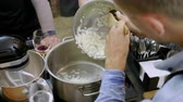 wine : The man stewing in the pan chopped onion at cooking master class. 4K