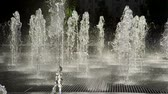 altyapı : Close-up shot of water drops of fountain in the summer park. Slow motion. HD Stok Video