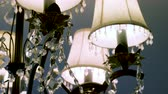 кулон : Crystal lamp. Vintage elegant chandelier on ceiling in a luxury living room. 4K Стоковые видеозаписи