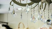 swarovski : Interior of house. Close-up shot of luxury crystals of a classic chandelier. 4K
