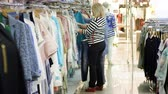 shopping : Two cheerful attractive adult women are shopping together in a department store. 4K