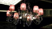кулон : Crystal lamp. Vintage elegant chandelier hanging on the ceiling in a luxury living room. 4K