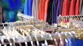 sem camisa : The interior of the clothing store. Close-up shot of rack of womens clothes. 4K