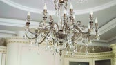 vitoriano : Crystal lamp. Vintage elegant chandelier hanging on the ceiling in a luxury living room. Slow motion. HD