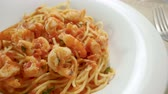 spaghetti allo scoglio : Close-up panoramic shot of spaghetti with shrimp. Seafood pasta on a white plate. Slow motion. HD