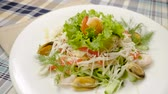 겨자 : Healthy salad with mussels, shrimps, squid, lettuce, tomatoes, cucumber, apple, cheese. Slow motion. HD