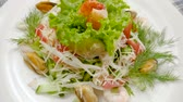 erva doce : Healthy salad with mussels, shrimps, squid, lettuce, tomatoes, cucumber, apple, cheese. Slow motion. HD