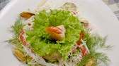 endro : Healthy salad with mussels, shrimps, squid, lettuce, tomatoes, cucumber, apple, cheese. Slow motion. HD