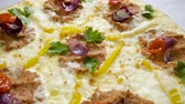 cominho : Italian food. Delicious traditional pizza topped with cream sauce, fresh parsley, dried tomatoes, red onion, parmesan cheese, bell pepper, minced beef meat, cumin seeds. Slow motion. HD