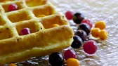 brunch'ı : Sweet breakfast. Close-up shot of viennese waffles with fresh berries, honey, syrup on a glass plate. 4K Stok Video