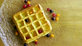 brunch'ı : Sweet breakfast. Top view of viennese waffles with fresh berries, honey, syrup on a glass plate. 4K