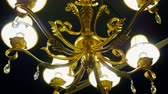 avize : Interior of room. Chandelier. Close-up shot of vintage lighting lamp with light bulbs on a ceiling. 4K