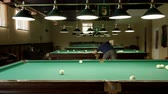 baize : Men playing billiards, hitting the balls with a cue into pockets on a billiard table. 4K Stock Footage