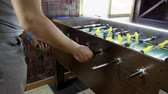 críquete : Sport, game concept. Foosball. Two men playing a table football or kicker with miniature players. 4K