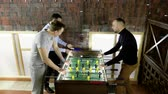 プラ : Sport, game concept. Foosball. Three men playing a table football or kicker with miniature players. 4K
