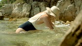 jadran : Attractive cheerful smiling blonde woman dressed in swimming suit and straw hat posing on beach, enjoying her travel, holiday and sea. Slow motion. HD Dostupné videozáznamy