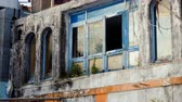costruzioni : Architecture of Greece. Broken window in building is an old abandoned hotel in Benitses. 4K Filmati Stock