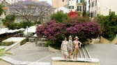 costruzioni : Three women posing for photo on the streets of Kerkira. Greece. 4K