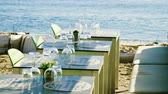 restoran : Four tables served to meet guests in the restaurant by the sea. 4K Stok Video