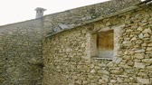 costruzioni : Architecture of Andorra. The exterior of an old stone house. 4K Filmati Stock