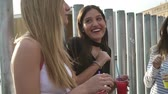 slushies : Women clinking slushie drinks together