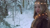 headpiece : Woman with illuminated headband in a snowfield Stock Footage