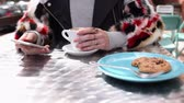coffee break : Woman checking her phone and taking a cup in coffee shop Stock Footage