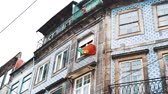 정체 : Flag of Portugal waving on a building