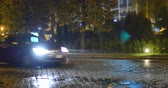 luxo : wet pavement street with car.