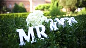 senhora : Sign for wedding Mr Mrs mister and missis with flowers in the grass