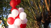 ribbon : white and red baloons green on background