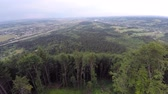 лиственный : The mountain ridge covered with forest. Mountain landscape. Drone video. Стоковые видеозаписи
