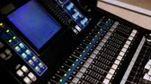 mix : 4K footage of a recording studios audio console and a hand pulling up the knobs The audio console
