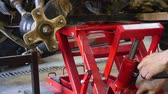 scrunch : ATV repair in garage. Quad bike repair Stock Footage