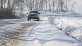 21.01.2018, Chernivtsi, Ukraine - Winter driving. Car drives by icy track on snow covered lake at winter. Sport car racing on snow race track in winter.