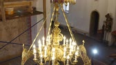 30.01.2018, Chernivtsi, Ukraine - Chandelier in the Church. Candles Are Lit on the Chandelier in the Orthodox Church. in the Background, a Large Iconostasis Wideo