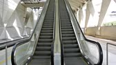 lyon : Working escalator in modern train station with unrecognizable person waiting on top, tilt up
