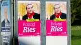 expression : STRASBOURG, FRANCE - MARCH 25, 2014: Electoral campaign has started in Strasbourg for the local municipal elections held on 30 March 2014. Roland Ries has won the election and is the actual mayor of Strasbourg