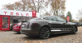 tesla motors : PARIS, FRANCE - 28 NOVEMBER 2014: Two electric cars, Tesla Model S 85 and Mode S85 Plus in front of the temporary showroom. Tesla Motors, Inc. is an American company that designs, manufactures, and sells electric cars and electric vehicle powertrain compo