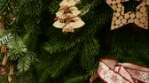 bokeh : Decorations on green Christmas tree with hand-made wooden toys. Panning on slow-motion Stock Footage