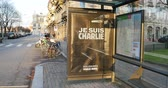 charlie hebdo : STRASBOURG,, FRANCE - 11 JAN, 2015: Bus stop with large Je Suis Charlie seen in French city after the unity rally (Marche Republicaine) where some 50000 people took part in tribute three-day killing spree in Paris