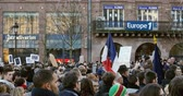 charlie hebdo : STRASBOURG, FRANCE - 11 JAN, 2015: French national Flag at Place Kleber during a unity rally (Marche Republicaine) where some 50000 people took part in tribute three-day killing spree in Paris - lens flare Stock Footage