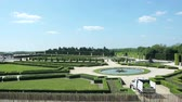 parterre : VERSAILLES, FRANCE - CIRCA SEPTEMBER 2014: Gardens of Palace of Versailles, France - with tourists admiring the park and fountains. Versailles is one of the most visited art museum in the world Stock Footage