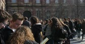 opportunities : STRASBOURG, FRANCE - MARCH 20, 2015: Panning over college students admiring through telescope the annular solar eclipse Stock Footage