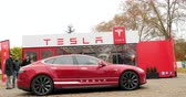 tesla motors : PARIS, FRANCE - CIRCA 2015: Rising-up of luxury Tesla Model S before the test-drive. Tesla is an American company that designs, manufactures, and sells electric cars