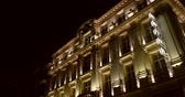 Luxury hotel facade at night with hotel sign Стоковые видеозаписи
