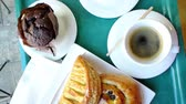 au : Viennoiseries - typical French breakfast with coffee, pain au chocolat, chausson pomme and escargot au raisins seen from above